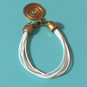Jewelry - White and gold bracelet with round spiral design